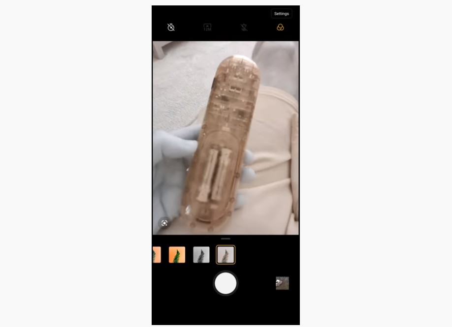 OnePlus 8 Pro see through camera effect shows internal circuitry of a TV remote